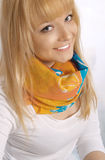 Happy young blond woman in an orange neckerchief Stock Photography