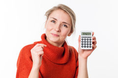 Happy young blond woman smiling, showing her calculator Stock Images