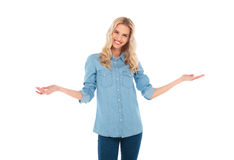 Happy young blonde casual woman welcoming you Royalty Free Stock Image