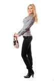 Happy young blonde with a handbag Royalty Free Stock Photo