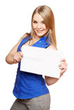 Happy young blonde holding empty white board Stock Images