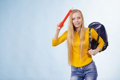 Young woman going to school Stock Images