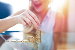 Happy young blonde woman building money column closeup Stock Images