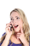 Happy Young Blonde Woman with Cell Phone Royalty Free Stock Photo