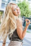 Happy young blonde woman with hat outdoor summertime Royalty Free Stock Photos