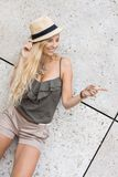 Happy young blonde woman with hat outdoor summertime Royalty Free Stock Image