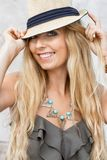 Happy young blonde woman with hat outdoor summertime Stock Images