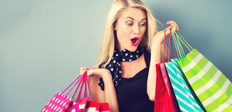 Happy young blonde woman with shopping bags Royalty Free Stock Photo