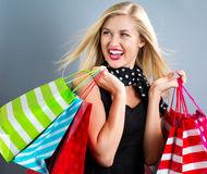 Happy young blonde woman with shopping bags Royalty Free Stock Photos