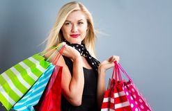 Happy young blonde woman with shopping bags Royalty Free Stock Images