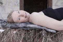 Happy young blonde woman smiling. In old castle and looking Royalty Free Stock Photo