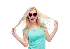 Happy young blonde woman or teenager in sunglasses Royalty Free Stock Photography