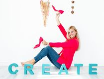 Happy young woman with toothy smile holding high heels stock photos