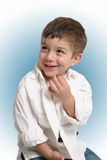 Happy young boy. Half body portrait of happy young boy with open white shirt, studio background Stock Photos