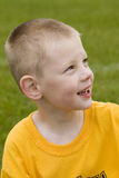 Happy Young boy. Here is a photo of a happy young boy talking to his teammate during a soccer game.  It is halftime and they are taking a break Royalty Free Stock Photos
