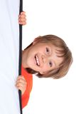 Happy young boy. Portrait of happy young boy looking around object with white background and copy space Stock Photo