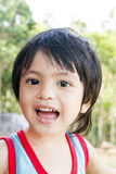 Happy young boy. Adorable happy Asian Thai young boy smiling for the camera Stock Photography