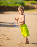 Happy young boy at the beach Royalty Free Stock Image