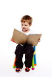 Happy young boy with book Stock Photo
