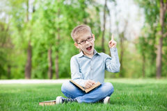 Happy young boy with a books Stock Image