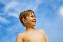 Happy young boy with brown hair  enyoys the tropical beach Royalty Free Stock Images
