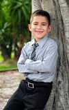 Happy Young boy in business attire. Happy Young boy leaning in business attire smiling with missing tooth Royalty Free Stock Photo