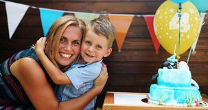 Happy young boy celebrating birthday with mother. Happy young boy celebrating his birthday with mother Royalty Free Stock Photo