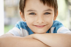 Happy Young Boy. Closeup portrait of happy young boy outdoors Stock Image