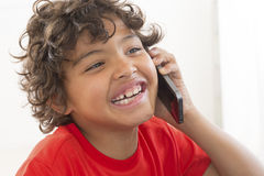 Happy young boy communicates with smartphone Stock Photography