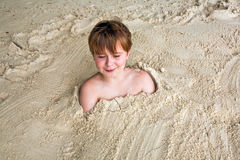 Happy Young Boy Covered By Fine Sand Stock Photos