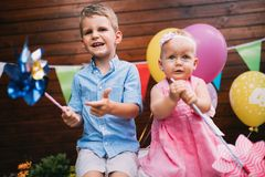 Happy young boy and little girl at birthday party. Happy young boy and cute little girl at birthday party Stock Photo