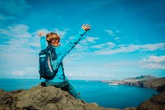 Happy young boy hiking travel in mountains stock images