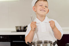 Happy young boy enjoying cooking Royalty Free Stock Photography