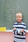 Happy young boy at first grade math classes. Solving problems and finding solutions Stock Image