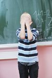 Happy young boy at first grade math classes Royalty Free Stock Photo