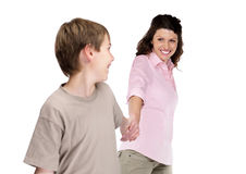 Happy young boy forcing his mother to walk Stock Photo