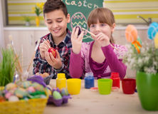 Happy young boy and girl playing with Easter eggs Royalty Free Stock Photography