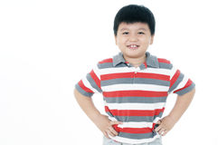 Happy young boy with hands on his hips Royalty Free Stock Image
