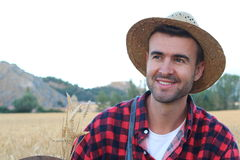 Happy young boy in hat walking on wheat summer field. Harvest concept Stock Photography