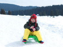 Happy young boy have fun on winter vacatioin on fresh snow Royalty Free Stock Image
