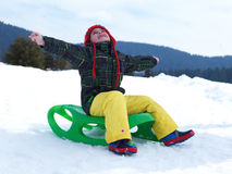 Happy young boy have fun on winter vacatioin on fresh snow Stock Images