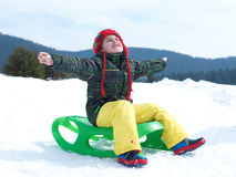 Happy young boy have fun on winter vacatioin on fresh snow Stock Photos