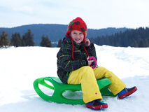 Happy young boy have fun on winter vacatioin on fresh snow Stock Photography