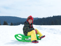 Happy young boy have fun on winter vacatioin on fresh snow Royalty Free Stock Photo