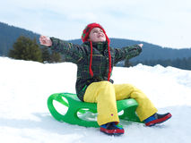 Happy young boy have fun on winter vacatioin on fresh snow Stock Photo