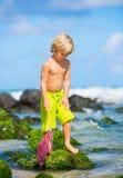 Happy Young boy having fun at the beach Royalty Free Stock Photos