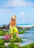 Happy Young boy having fun at the beach Stock Photos