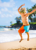 Happy Young boy having fun at the beach Royalty Free Stock Photo