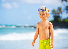 Happy Young boy having fun at the beach Stock Image