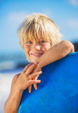 Happy Young boy having fun at the beach on vacation Stock Photo